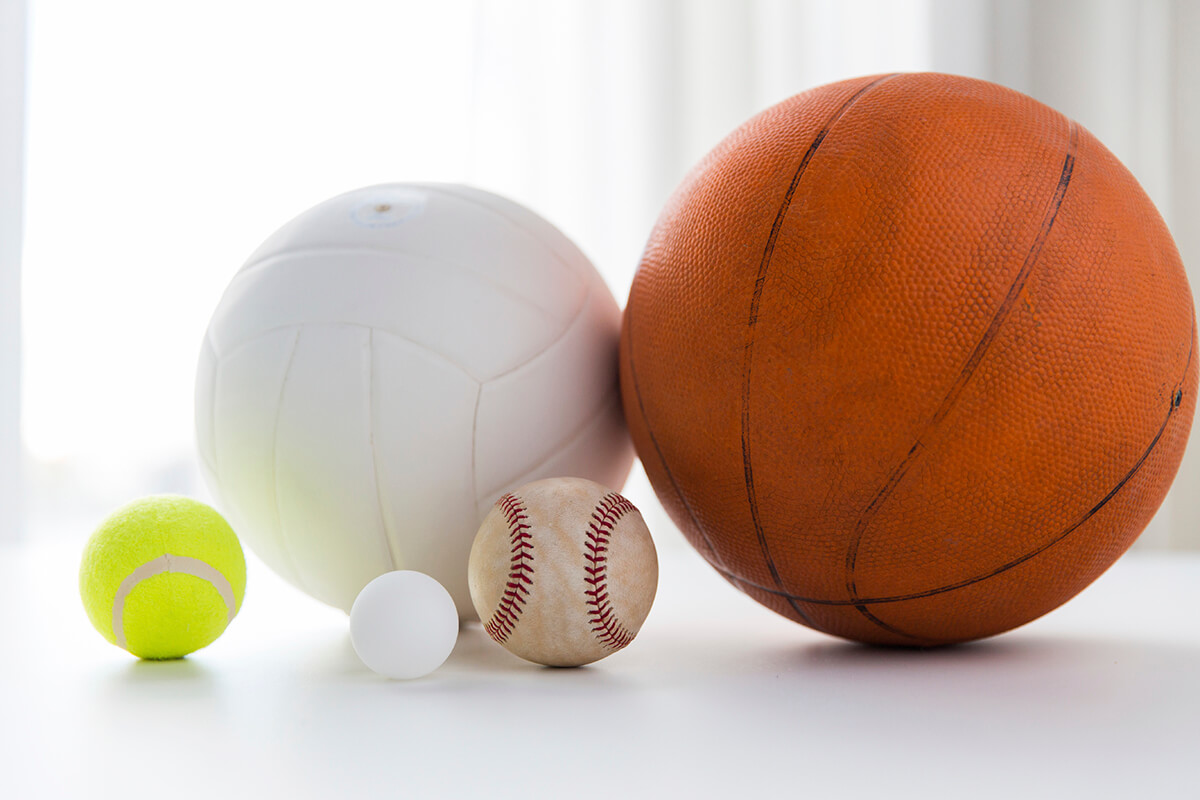 sport, fitness, game and objects concept - close up of different sports balls set