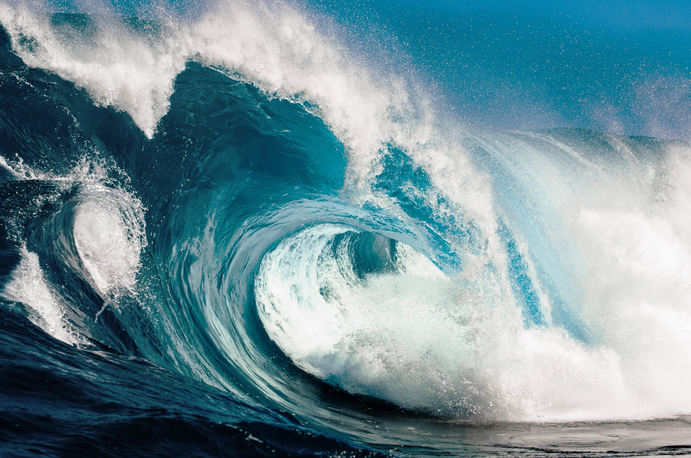 Looking in to the eye of a huge blue wave.