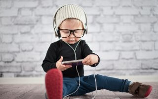 Little nerd with music player