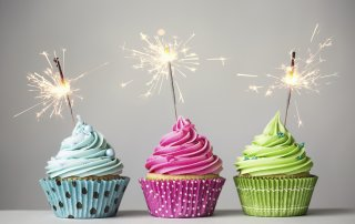 Row of three cupcakes with sparklers